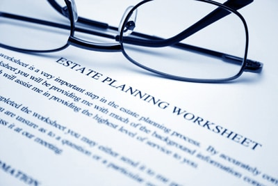 Image of Glasses and writing to show Funeral Plans in York for CJS Legal Services Ltd
